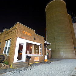 Closed for the evening, the Farmers Coop grain elevator in downtown Watseka, IL still displays the current prices for corn and beans for farmers to see as they drive by on the main street.