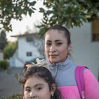 """I want to attend college and study child development...it's never too late.""  -Ivonne Sandoval walks home with her seven year old daughter, Leslie, on Third Street in Calistoga"