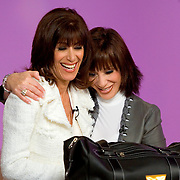 SPECIAL TO THE PALM BEACH POST---Adrienne Arpel, right, hugs host Bobbi Ray Carter during a break in their live show for her Signature A cosmetics at the Home Shopping Network on Friday, March 18, 2005 in St. Petersburg, Fla. (AP Photo/Scott Audette)