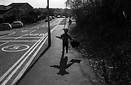 Ben, wearing a Yoda knitted hat, runs to the car after school pick up in Berkhamsted, England Wednesday, March 25, 2015 (Elizabeth Dalziel) #thesecretlifeofmothers #bringinguptheboys #dailylife