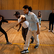 From left; Karen Polanco, 17, Jason Gooden, 17 and peer leader Brander Suero, 16, play basketball during Physical Education class in the gym at Central Park East High School in New York, NY on November 15, 2012. Beyond sheer physical safety, a look at how schools and districts can create classroom conditions in which students are able to engage enthusiastically and without emotional fear of stepping forward. Photographer: Melanie Burford/Prime