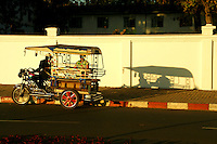 Tuk Tuk at Sunset - An auto rickshaw or three wheeler is one of the most popular modes of transport across many parts of Southeast Asia, including Vientiane which has its own special type of tuktuk.
