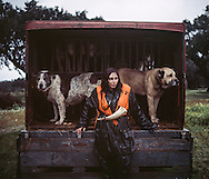 Ana Parreira, tracking dog handler. <br /> <br /> <br /> &quot;The Pose and the Prey&quot;<br /> <br /> Hunting in my imagination was always more like taxidermy &mdash; as if the prey was just a mere accessory of the hunter's pose for his heroic photograph &mdash; the real trophy.<br /> <br /> When I decided to document the daily lives of Portuguese hunters, I had in my memory the &quot;clich&eacute;&quot; from the photographer Jos&eacute; Augusto da Cunha Moraes, captured during a hippopotamus hunt in the River Zaire, Angola, and published in 1882 in the album Africa Occidental. The white hunter posed at the center of the photograph, with his rifle, surrounded by the local tribe.<br /> <br /> It was with this clich&eacute; in mind that I went to Alentejo, south of Portugal, in search of the contemporary hunters. For several months I saw deer, wild boar, foxes. I photographed popular hunting and private hunting estates, wealthy and middle class hunters, meat hunters and trophy hunters. I photographed those who live from hunting and those who see it as a hobby for a few weekends during the year. I followed the different times and moments of a hunt, in between the prey and the pose, wine and blood, the crack of gunfire and the murmur of the fields .<br /> <br /> I was lucky, I heard lots of hunting stories. I found an essentially old male population, where young people are a minority. Hunters, a threatened species by aging and loss of economic power caused by the crisis in the South of Europe.<br /> <br /> The result of this project is this series of contemporary images, distant from the &quot;cliche&quot; of 1882.<br /> <br /> &mdash; Antonio Pedrosa