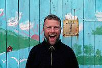 Gone surfing -sign on a blue painted boat house in Hoddevika, Stadt - Blåmalt naust