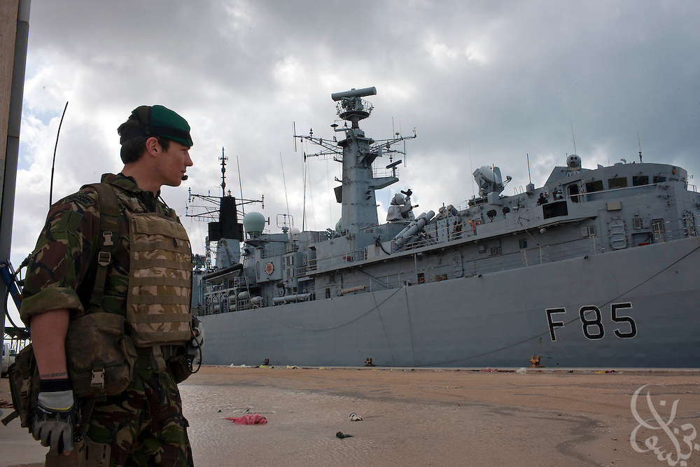 A UK Royal Marine from the British Royal Navy frigate HMS Cumberland takes up a security position during an evacuation mission of UK, EU and United States citizens February 27, 2011in Benghazi, Libya. Most Western countries have closed their embassies in Libya, and have advised citizens that they should leave the country while they still can..Slug: Libya.Credit: Scott Nelson for the New York Times