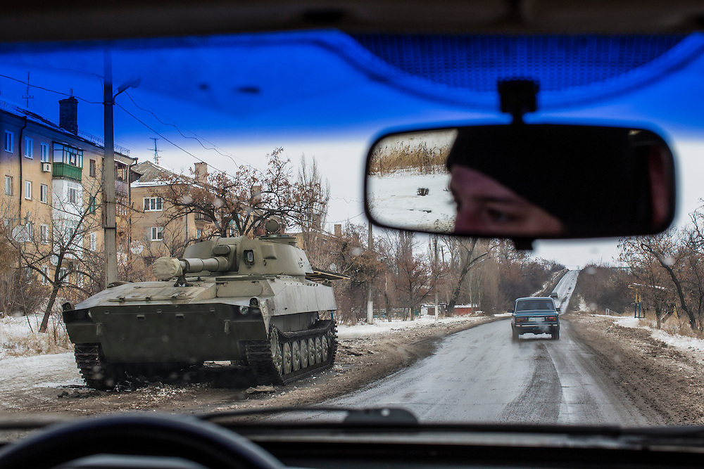 SHAKTARSK, UKRAINE - DECEMBER 8, 2014: A tank is parked by the road in Shaktarsk, Ukraine. CREDIT: Brendan Hoffman for The New York Times