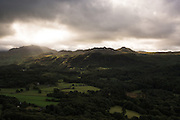 Sunrays through stormy clouds over the Eskdale valley in the Lake District, UK.