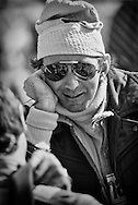 Ulsterman John Watson had the &quot;gift of gab.&quot;  Close with many fellow drivers, Watson could be seen chatting up any and all during his 12 years in Formula One. He won his first Grand Prix for Roger Penske at the 1976 Austrian Grand Prix. <br /> <br /> Here in 1977 at the United States Grand Prix, Watson would qualify his Martini Brabham Alfa Romeo second, but, with a light drizzle for the race, the team ordered Watson to start on Goodyear dry racing &quot;slicks&quot; on the chance that the track might dry and Watson would have a distinct advantage. The rain continued until the final few laps. Watson would finish 12th.<br /> <br /> Watson would go on to race with Marlboro McLaren scoring two more wins at Detroit and Long Beach and finishing 3rd in the 1982 World Championship standings.<br /> <br /> After he retired, Watson became a racing commentator with the BBC.
