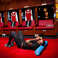 MIAMI, FL -- January 29, 2012 -- Miami forward LeBron James takes out his earrings to stretch in the Heat's locker room prior to their 97-93 win over the Chicago Bulls at American Airlines Arena in Miami, Fla., on Sunday, January 29, 2012.  (Chip Litherland for ESPN the Magazine)