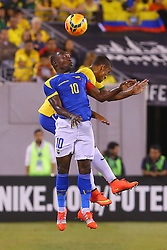 Sep 9, 2014; East Rutherford, NJ, USA; Ecuador defender Walter Ayovi (10) heads the ball during the first half at MetLife Stadium.