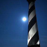 19 August, 2005:  A full moon rises over the Cape Hatteras Light House in Buxton, NC on August 19., 2005.  (Mark Goldman)