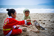Christmas Day, 2011. Young children play on the beach in Nha Trang, Vietnam.