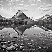 reflection on pray lake sinopah mountain glacier national park