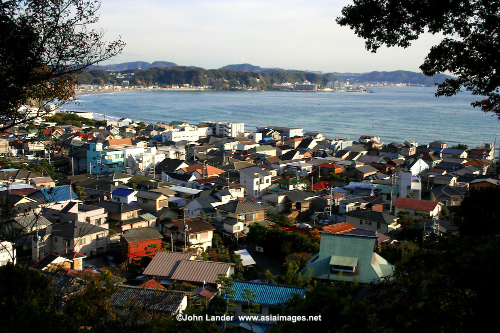 """Kamakura Cityscape - it's hard to believe that this quiet little town with its many temples was the political capital of Japan during the Kamakura shogunate, from 1185 to 1333. The period is usually known as the """"Kamakura Period"""". These days Kamakura is a very popular day trip from Tokyo for locals and tourists alike. Its principle draws are Shonan Beach, temples, gardens and nature trails."""