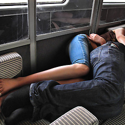 A young couple sleeps on the train from Marrakech to Casablanca after a long night out in Marrakech, Morocco on May 9, 2009.