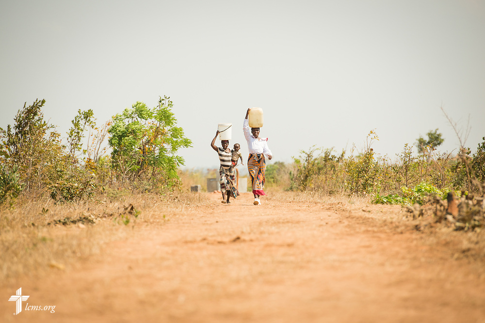 Women carry fresh water from a new LCMS funded well on Saturday, Sept. 26, in Embangweni, Malawi. LCMS Communications/Erik M. Lunsford