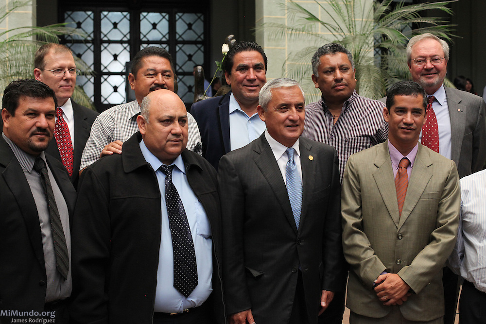 Guatemalan President Otto Perez Molina (bottom row, third from left) poses with San Rafael Las Flores Mayor Leonel Morales (bottom row, second from left), San Rafael Mine President Donald Paul Gray (top row, first from left), Canadian Ambassador Hughes Rousseau (top row, fifth from left), and other Mayors from adjacent municipalities to the San Rafael Mine, after the signing of the official convene between the Guatemalan government and Tahoe Resources & Goldcorp's El Escobal silver project via its local subsidiary Minera San Rafael. The signing comes two days after six locals were shot by the company's security guards. Since 2011, eight local communities have carried out plebiscites that have rejected nearly unanimously the mining project in San Rafael Las Flores, Santa Rosa. Guatemala City, Guatemala. April 29, 2013.