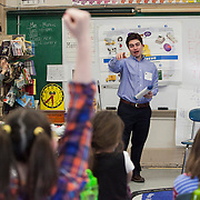 Junior Achievement is a program whose participants visit local elementary schools to teach basic economic and business concepts. For ?JA in a Day,? Tufts students visited the Brown School and taught Junior Achievement lessons throughout the day in various classes. (Kelvin Ma/Tufts University)