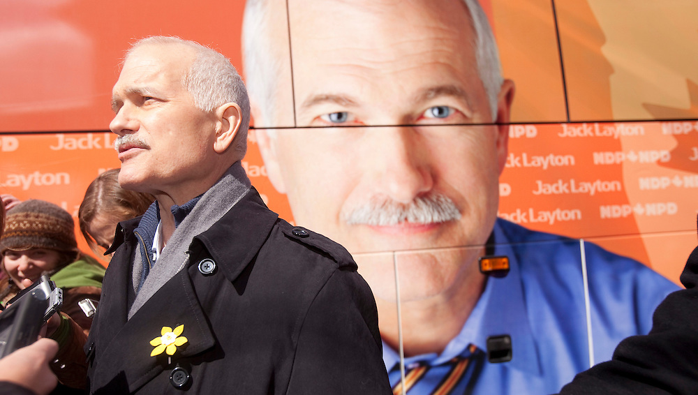 NDP leader Jack Layton speaks to the media during a campaign stop at Webco Sports in Kitchener, Ontario, March 29, 2011. <br /> AFP/GEOFF ROBINS/STR