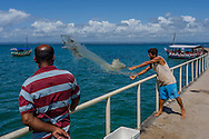 A man practicing fishing with a nylon net in The Harbour Of Barra Grande, Maraú Peninsula, in the brazilian state of Bahia. Diego Murray / 4See