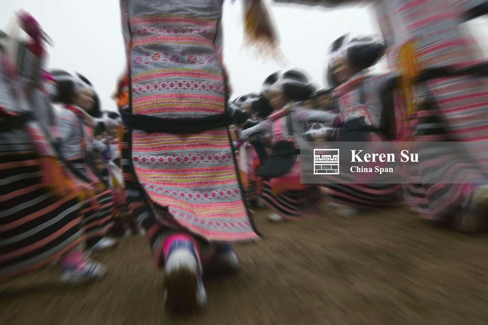 Long Horn Miao people dance at Flower Dance Festival, Suoga, Guizhou, China