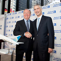 United CEO Glenn Tilton,left, and Continental CEO Jeff Smisek announce a merger that will create the world's largest airline.