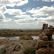 This is the view from 14,265 ft at the top of Mt. Evans. A little pool of water and cairns were the perfect foreground for the beautiful clouds in the sky