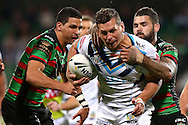 PERTH, AUSTRALIA - JUNE 05:  Greg Bird of the Titans gets tackled by Adam Reynolds of the Rabbitohs during the round 13 NRL match between the South Sydney Rabbitohs and the Gold Coast Titans at nib  Stadium on June 5, 2016 in Perth, Australia.  (Photo by Paul Kane/Getty Images)
