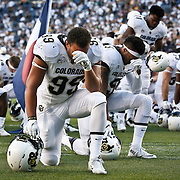 SHOT 9/19/15 5:02:12 PM - Colorado's Aaron Howard #99 takes a knee with teammates in the endzone before playing against Colorado State during the Rocky Mountain Showdown at Sports Authority Field at Mile High in Denver, Co. Colorado won the game 27-24 in overtime. (Photo by Marc Piscotty / © 2015)