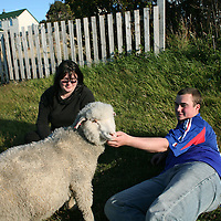 Sian Ferguson, 21, left, and Karl Nightingale, 21, right, enjoy time in the sun with their pet lamb Skippy in Stanley, the capital of the Falkland Islands, on Wednesday, March 21, 2007. This year is the 25 anniversary of the war for sovereignty of the islands between the United Kingdom and Argentina. The two-month war resulted in the withdrawal of Argentinean forces and the islands remained part of the United Kingdom. After the war on the islands there has been strong economic development. (Photo/Scott Dalton)