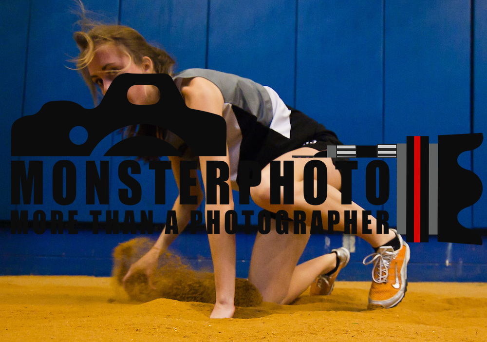 021211 Newark DE: Cape Henlope Senior Hannah Pepper shown after landing in the sand during triple jump event at the state indoor track and field championships at The University of Delaware Field House in Newark Delaware Saturday afternoon.<br /> <br /> Special to The News Journal/SAQUAN STIMPSON