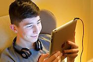 Teenage Boy using Apple Ipad - Feb 2013.