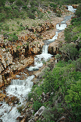 Water gushes down a waterfall in Talbot Gorge on Mt Hart Station on the Kimberley's Gibb River Road.  During the wet the station can be isolated for up to 6 months.