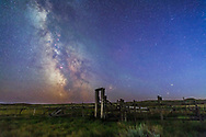 Mars (bottom) and Saturn in conjunction at right, and the Milky Way at left, in deep blue twilight before the sky got filly dark, over the old corral of the 76 Ranch, in Grasslands National Park, Saskatchewan, August 27/28, 2014. Antares and Scorpius are just behind the corral gate at right, Sagittarius is at left in the Milky Way. M6 and M7 open cluster are visible at left.<br /> <br /> This is a composite of two images: one tracked (for the sky) and one untracked (for the ground) images, both 60 second expsosures at f/2.8 with the 24mm lens and Canon 5D MkII at ISO 2000. The tracker was the Sky-Watcher Star Adventurer.