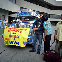 A young man receives a welcom at the Overseas Workers Welfare Administration, OWWA, in Manila, Philippines on Dec. 2006. OWWA held several holiday events giving out many prizes to workers throughout the Philippines to welcome the roughly 120,000 OFWs that came home for the Christmas season. Even President Gloria Macapagal-Arroyo took time out of her busy schedule to greet returning OFWs at the Ninoy Aquino International Airport.