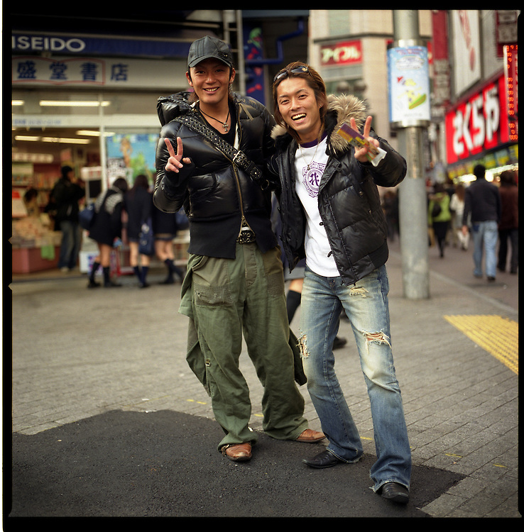 Gal-O modeling agency or hostess bar recruiters on street in Shibuya, Tokyo, Japan.