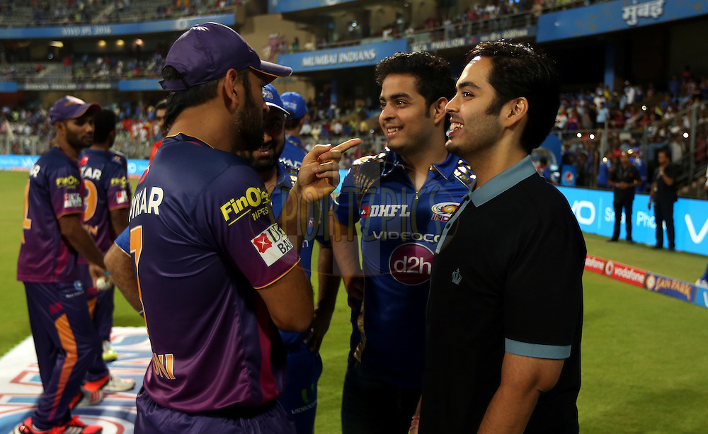 Rising Pune Supergiants captain MS Dhoni ,Akash and  Annath Ambani son of Nita Ambani during match 1 of the Vivo Indian Premier League ( IPL ) 2016 between the Mumbai Indians and the Rising Pune Supergiants held at the Wankhede Stadium in Mumbai on the 9th April 2016<br /> <br /> Photo by Sandeep Shetty/ IPL/ SPORTZPICS