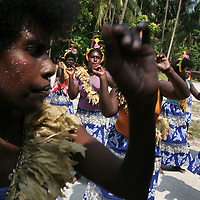 """""""Welcome ceremony"""" on Han Island, Carteret Atoll, Papua New Guinea, on Sunday, Dec. 10, 2006. Rising sea levels have eroded much of the coastlines of the low lying Carteret islands (situated 80km from Bougainville island, in the South Pacific), and waves have crashed over the islands flooding and destroying what little crop gardens the islanders have. Food is in short supply, banana and swamp taro crops are failing due to the salt contamination of the land, and the islanders live on a meagre one meal per day diet of fish and coconut. There is talk by the Autonomous Region of Bougainville government to relocate the Carteret Islanders to Bougainville island, but this plan is stalled due to a lack of finances, resources, land and coordination."""