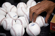 President Barack Obama signs baseballs for the umpires -- All-Star Game, Busch Stadium, St. Louis, MO