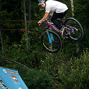 SHOT 7/28/11 2:35:42 PM - Anthony Messere, 15, drops in off a jump at Crankworx Colorado in the Trestle Bike Park at Winter Park, Co. Messere finished 18th after a surprise third place finish at Kokanee Crankworx. The event is a Pro-am mountain bike competition featuring a dual slalom race, the Trestle Unchained Challenge, slopestyle and cross country racing events where top pros competed for more than $35,000 in prize money. (Photo by Marc Piscotty / © 2011)