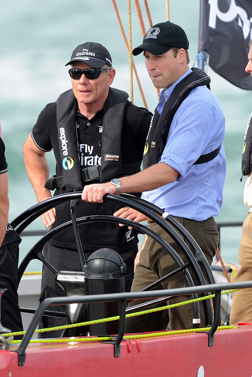 Britain's Prince William, right, with New Zealand Americas Cup CEO Grant Dalton as he races an Americas Cup yacht against his wife, Catherine, Duchess of Cambridge on the Waitemata Harbour, Auckland, New Zealand, Friday, April 11, 2014.  Credit:SNPA / Ross Setford
