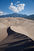 Great Sand Dunes, rise some 700 feet above the San Luis Valley, in the shadow of the Sangre De Cristo Mountains, including Mt. Herard.