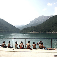 Young boys on Scutari lake.There are several arguments about the derivation of the name  &quot;Montenegro&quot;, one of these relates to dark and deep forests  that once covered the Dinaric Alps, as it was possible to see them from the sea. <br />