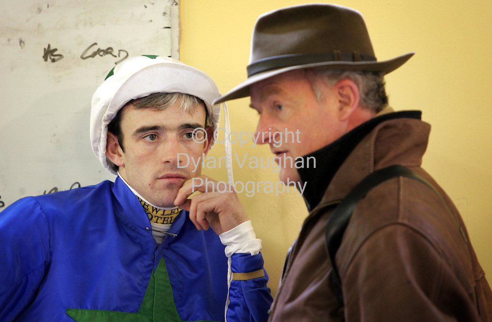6/1/2005.Ruby Walsh pictured in the weigh room with Willie Mullins before a days racing at Thurles..Picture Dylan Vaughan