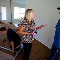 TAMPA, FL -- March 22, 2011 -- Shannon Moore, broker/owner of Green Lion Realty,talks with investor Steve Barnhardt in North Port, Fla., 2011.  A recent study showed that one and five homes in the state of Florida is vacant.