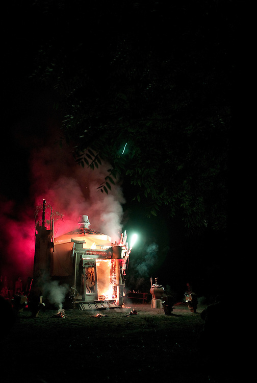 Fireworks go off as the Effigy burns.