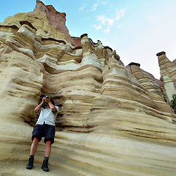 Price Chambers takes a photograph at Red Rock State Park near Gallup, NM.