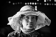 Portrait of a young woman working at an agricultural warehouse.