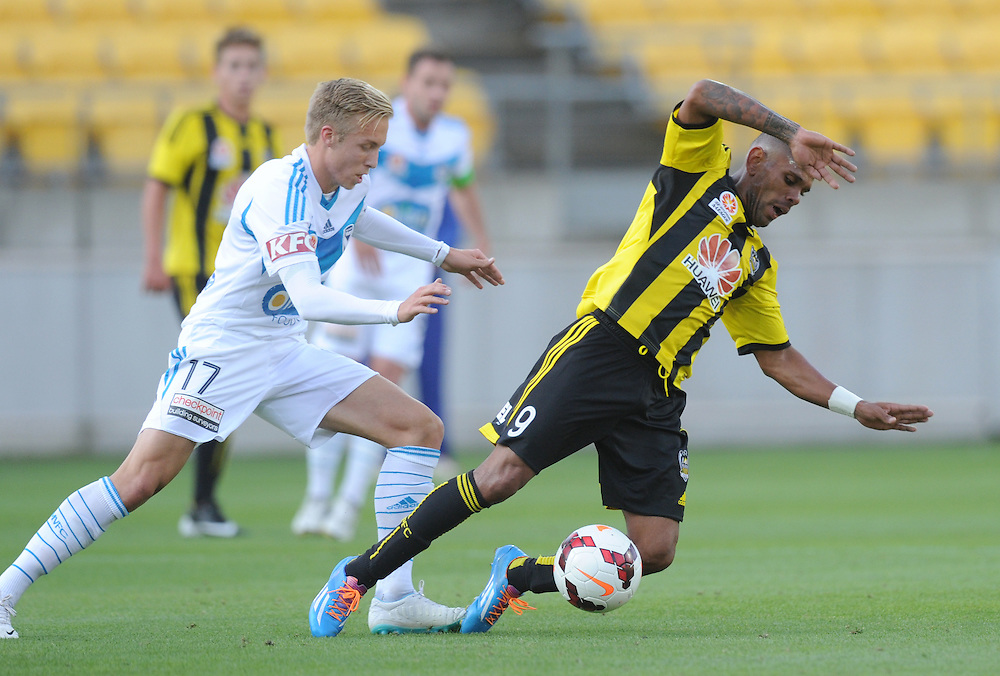 Phoenix's Kenny Cunningham, right, is tackled by Melbourne Victory's James Jeggo in the A-League football match at Westpac Stadium, Wellington, New Zealand, Saturday, Januray 18, 2014. Credit:SNPA / Ross Setford