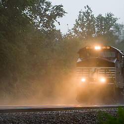 Blasting upgrade through a heavy rain storm, an eastbound Norfolk Southern freight train is undeterred by the inclement weather.